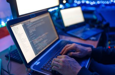Programmer hands on laptop keyboard, computer technology. IT-manager at his workplace, professional coding and encryption, network security